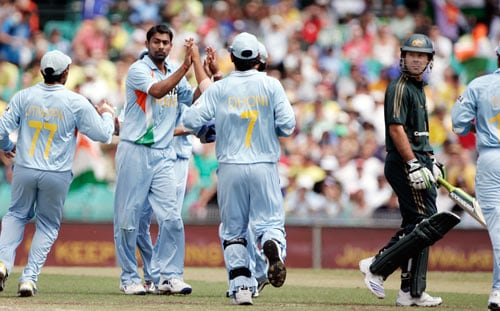 Praveen Kumar, second left, is congratulated by teammates after bowling out Australia's captain Ricky Ponting, right, for 4 runs during the first final of their tri-nations one-day international series at the Sydney Cricket Ground on Sunday, March 2, 2008.