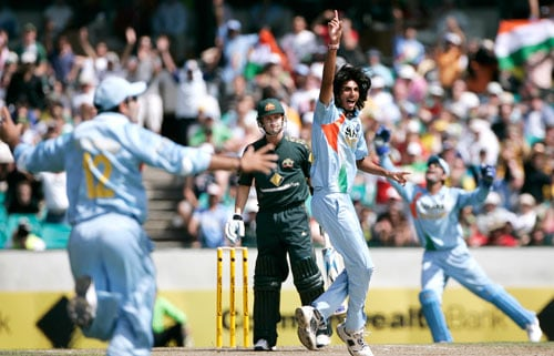 Ishant Sharma, second right, celebrates after taking the wicket of Michael Clarke, second left, for 4 runs during the first final of their tri-nations one-day international series at the Sydney Cricket Ground on Sunday, March 2, 2008.
