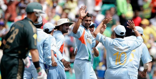Praveen Kumar, fourth right, celebrates with teammates after taking the wicket of Adam Gilchrist during the first final of their tri-nations one-day international series at the Sydney Cricket Ground on Sunday, March 2, 2008.
