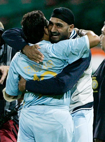 Sachin Tendulkar, left, and MS Dhoni celebrate after India won the first final of their tri-nations one-day international series against Australia in Sydney on Sunday, March 2, 2008. India won by six wickets with Tendulkar not out for 117 runs.