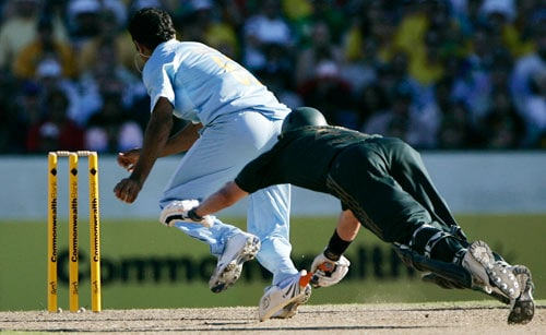 Michael Hussey, right, dives in an attempt at avoiding a run out as Irfan Pathan races to the stumps to dismiss Hussey for 45 runs during the first final of their tri-nations one-day international series at the Sydney Cricket Ground on Sunday, March 2, 2008.