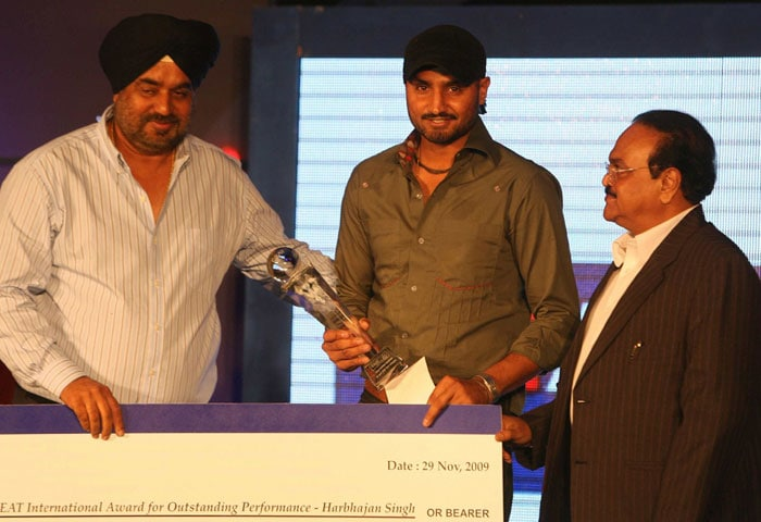 Harbhajan Singh is felicitated with the Ceat Award for claiming 300 wickets during the Ceat Cricket Awards 2008-09 in Mumbai. (PTI Photo)