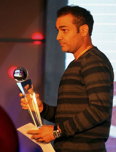 Virender Sehwag receives the Ceat ODI Batsman of the Year Award 2008-2009 in Mumbai. (PTI Photo)