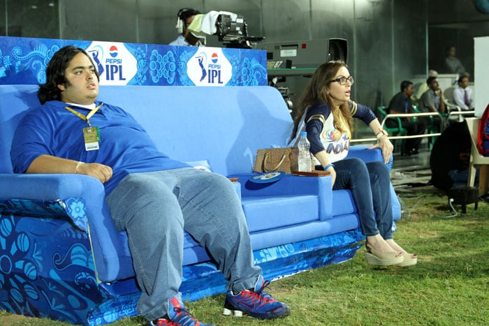 Nita Ambani, who is a passionate Mumbai Indian and a proud owner, is seen in the company of her son during a match at the IPL 2013. (Image credit: BCCI)