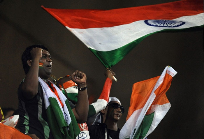 Indian fans wave the tricolour as they celebrate victory during the finals of ICC Cricket World Cup 2011 match between India and Sri Lanka at the Wankhede Stadium in Mumbai on April 2, 2011.(Photo courtesy: AFP)