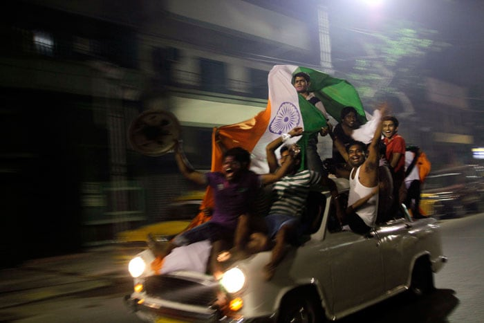 Car loads of ecstatic fans zooom by. (Photo courtesy: AP)
