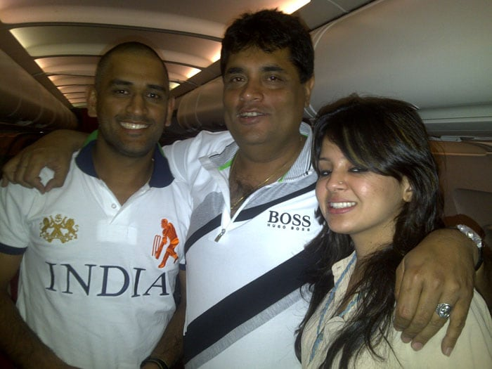 Captain Cool MS Dhoni and his wife Sakshi pose with a lucky fan on a flight.