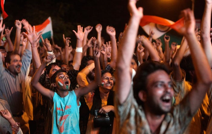 Fans celebrate on the streets with joy. (Photo courtesy: AP)