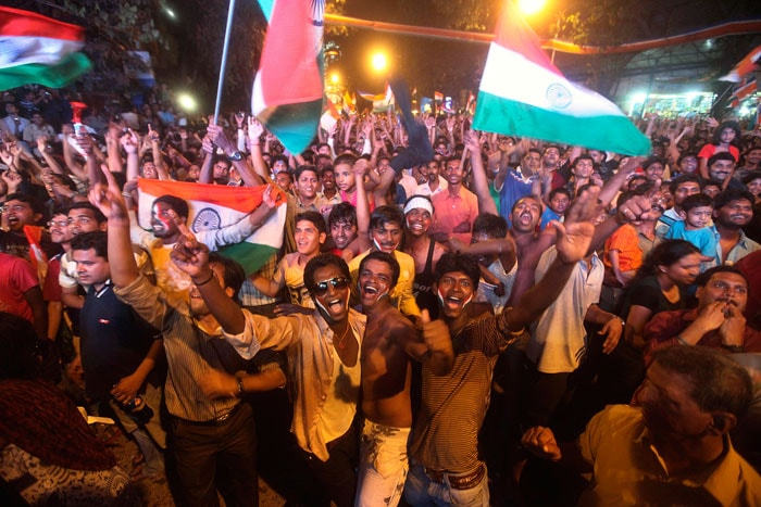 Ecstatic fans take to the streets. (Photo Courtesy: AP)