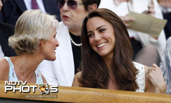 Kate talks with Gill Brook, left, wife of Chairman of the All England Lawn Tennis Club Philip Brook, on centre court at the All England Lawn Tennis Championships.