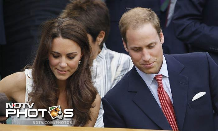 William and Kate take their seats on centre court prior to the start of play between Britain's Andy Murray and Richard Gasquet.