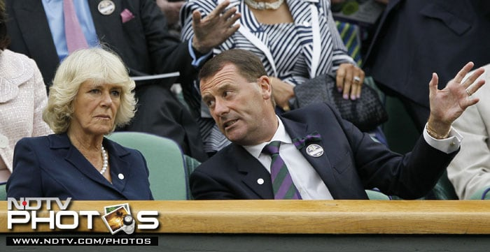 Britain's Camilla, Duchess of Cornwall sits with the Chairman of the All England Lawn Tennis Championships Philip Brook at the Championships at Wimbledon. (AP Photo)