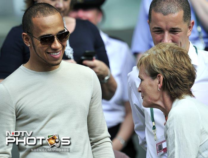 F1 team McLaren's driver Lewis Hamilton, who is in Britain for his home Grand Prix, took out time to watch his British compatriot Andy Murray in action against Feliciano Lopez in the Wimbledon quarter-finals. Hamilton is seen here with Murray's mother Judy. (AFP Photo)