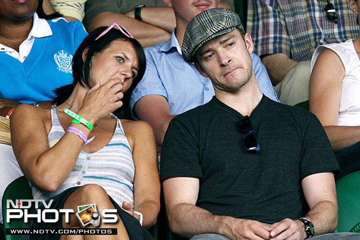 Seldom without girl company, singer and actor Justin Timberlake avoids going solo at Wimbledon 2009 as well.