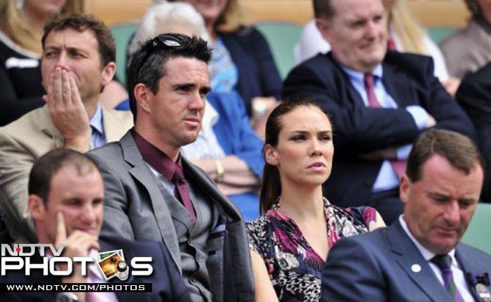 England cricketer Kevin Pietersen watches the action on Centre Court as Swiss player Roger Federer plays against Kazakh player Mikhail Kukushkin during a Men's Singles match at the 2011 Wimbledon Tennis Championships at the All England Tennis Club. Former England cricketer Michael Atherton is seen behind Pietersen. (AFP Photo)