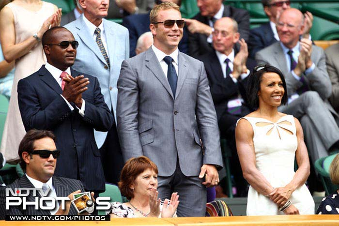 Lara (L), is joined by another sporting hero, Sir Chris Hoy, cycling great and Britain's most successful Olympian, at the famous Centre Court.