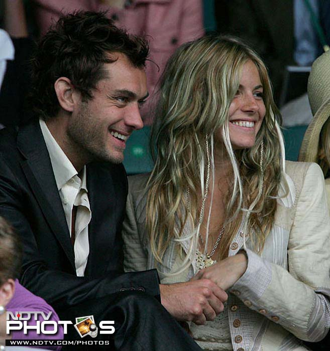 The on and off couple and Hollywood stars, Jude Law and Sienna Miller, during their early courtship days in 2004, prefer to watch Tim Henman in action at Wimbledon, than a cozy romantic outing.