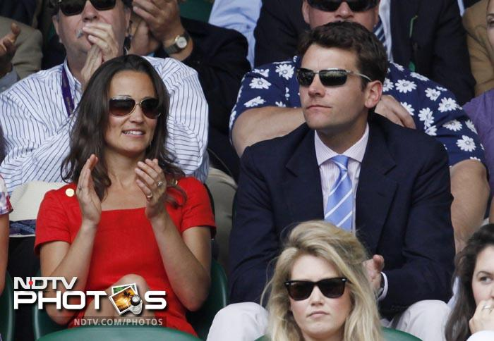 Two days after the Duchess of Cambridge, Kate, paid a visit to the Wimbledon centre court along with husband and Duke of Cambridge Prince William, her sister Pippa Middleton, was in attendance on the same court. Pippa was accompanied by former England cricketer and her boyfriend Alex Loudon at the All England Lawn Tennis Championships. (AP Photo)