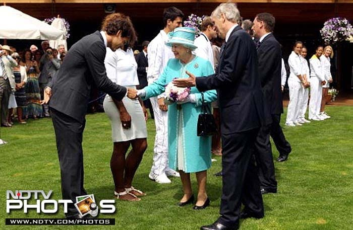 Britain's Queen Elizabeth greets Roger Federer and other tennis stars as she arrives for the 2010 Wimbledon, her first visit to the tournament after 1977.