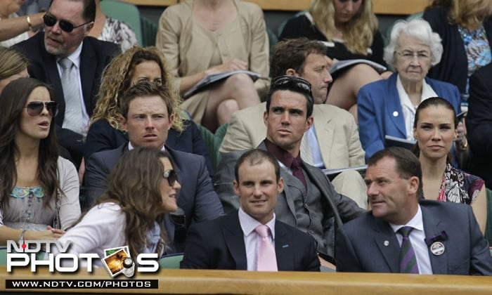 Britain's cricket captain Andrew Strauss, front center, and his wife Ruth, front left, sit with All England Lawn Tennis Club Chairman Philip Brook, front right, and cricketers Kevin Pietersen, center second row, Ian Bell and their wives as they watch play on Centre Court at the All England Lawn Tennis Championships at Wimbledon. (AP Photo)
