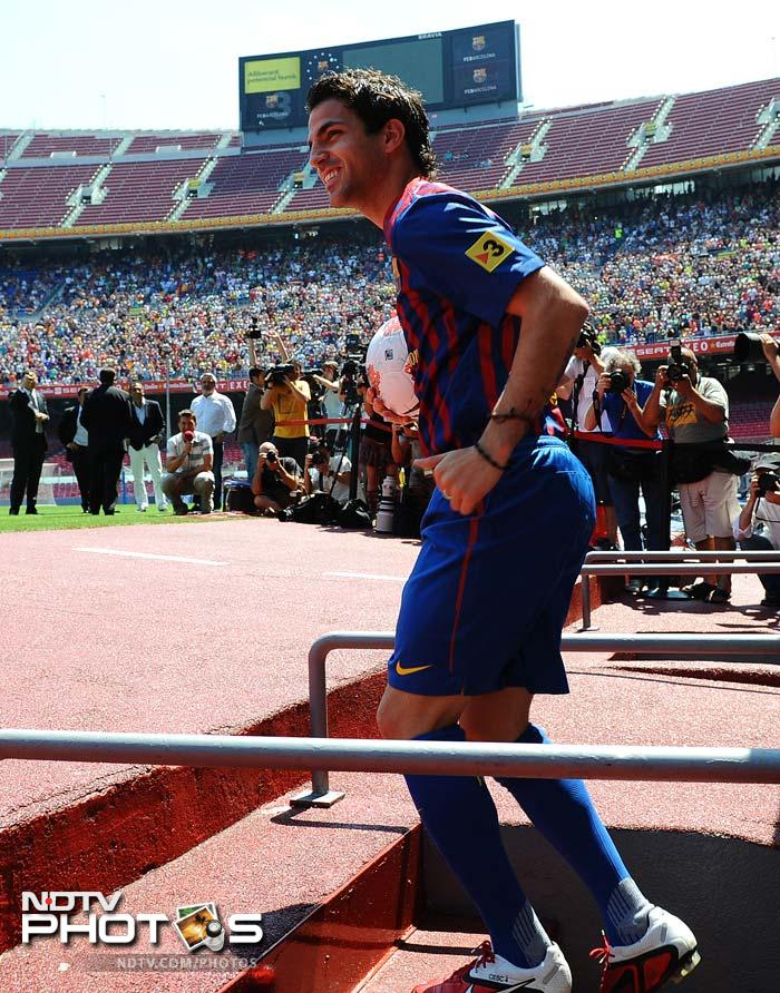 Fabregas enters the Camp Nou's stadium in Barcelona for his official presentation.