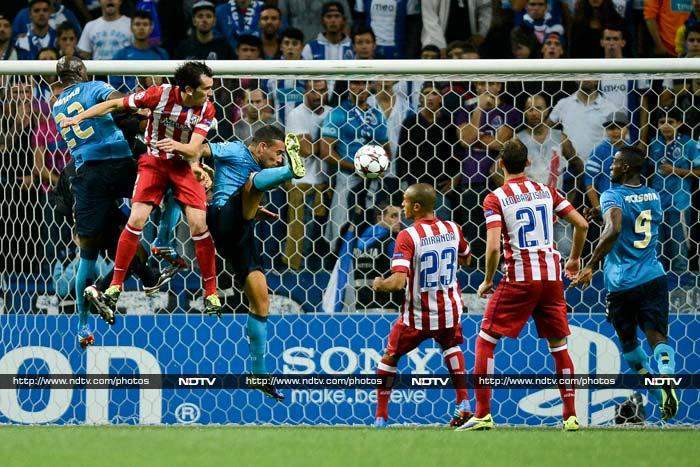 In Porto, Turan scored the winner four minutes from time as Atletico Madrid rallied to secure a 2-1 win.