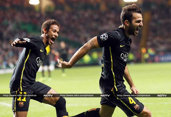 Borussia Dortmund and Chelsea recovered from poor starts in the Champions League by winning their first group matches on Tuesday, while Barcelona beat 10-man Celtic 1-0 to avoid a second consecutive loss at Celtic Park. (All AFP and AP images)