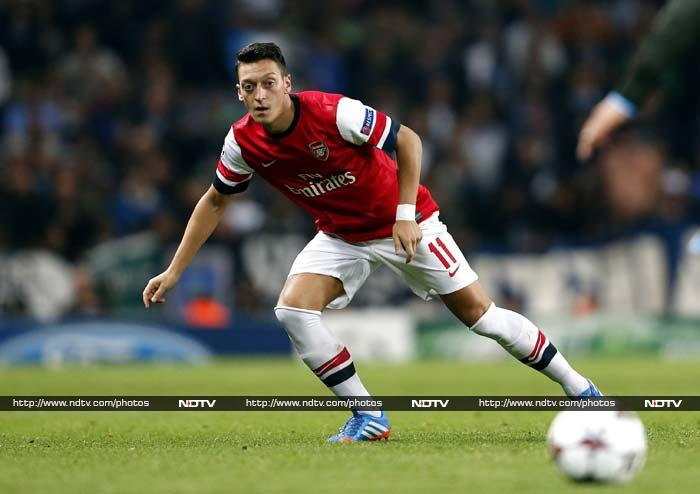 At the Emirates, Mesut Ozil again proved to be an excellent signing for Arsene Wenger's team as the Gunners took command of the group, three points clear at the top ahead of Dortmund's visit on Oct. 22. <br> Ozil's first goal since becoming Arsenal's most expensive player and another strike from Olivier Giroud within the opening 15 minutes were ideal presents for Wenger, who celebrated 17 years in charge at the London club.