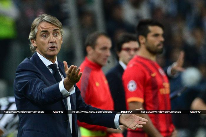 Manchester City's former coach Roberto Mancini steered Galatasaray to a 2-2 draw at Juventus, just two days after taking charge of the Turkish side.
