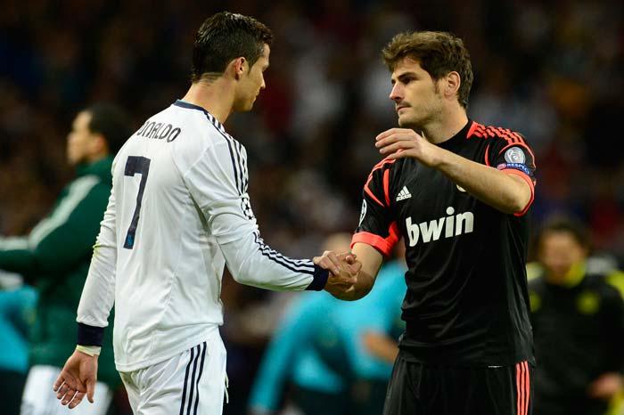 Real Madrid's goalkeeper and captain Iker Casillas (R) comforts Real Madrid's Portuguese forward Cristiano Ronaldo despite a 2-0 win at the end of the UEFA Champions League semis against Borussia Dortmund.