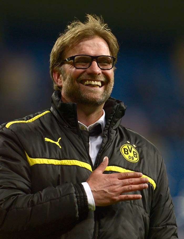 Dortmund's head coach Juergen Klopp heaves a sigh of relief and celebrates at the end of the UEFA Champions League semi-final second leg match at the Santiago Bernabeu stadium in Madrid on April 30, 2013.