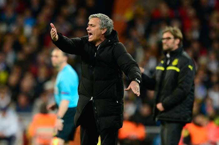 Real Madrid's Portuguese coach Jose Mourinho reacts during the UEFA Champions League semi-final second leg football match Real Madrid CF vs Borussia Dortmund at the Santiago Bernabeu stadium in Madrid on April 30, 2013. He later hinted a return to English football.
