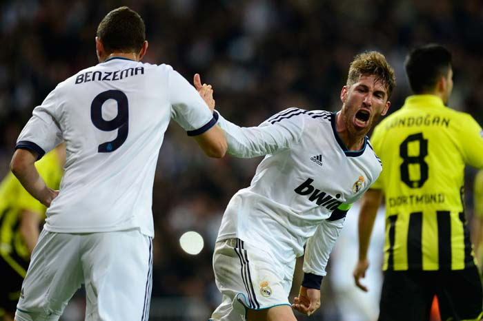 Real Madrid's defender Sergio Ramos (R) celebrates with Real Madrid's French forward Karim Benzema after scoring during the UEFA Champions League semi-final second leg tie against Borussia Dortmund. Benzema score the first goal of the match in the 82nd minute.