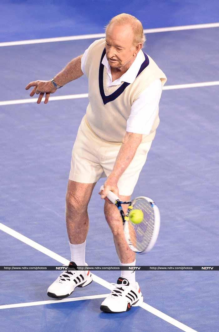 Australian legend Rod Laver, the only man twice to have won all four grand slam tournaments in a calendar year, took to the Melbourne Park court named in his honour wearing a vest, shorts and tennis shoes.