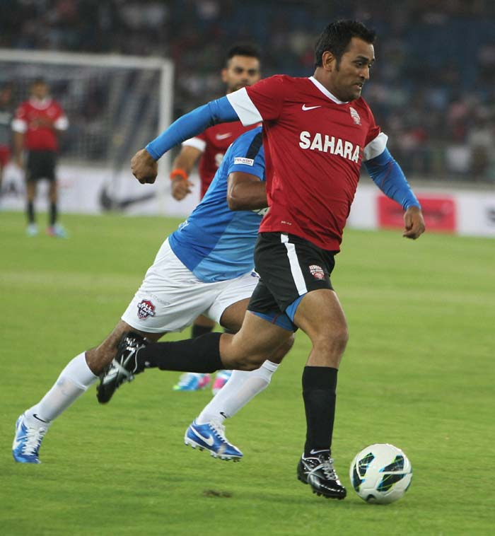 Indian cricketers including MS Dhoni, Yuvraj Singh and Harbhajan Singh took on Bollywood and TV actors in a charity football match at the Jawaharlal Nehru Stadium. <br><br> A look at their 4-3 victory. (All images courtesy PTI)