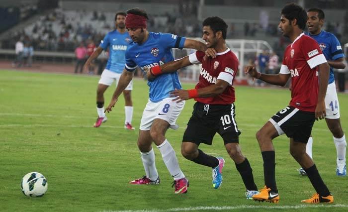 Ranbir Kapoor is seen here trying to retain possession against Manoj Tiwary. The actor scored two of the three goals, much to the joy of his fans here.