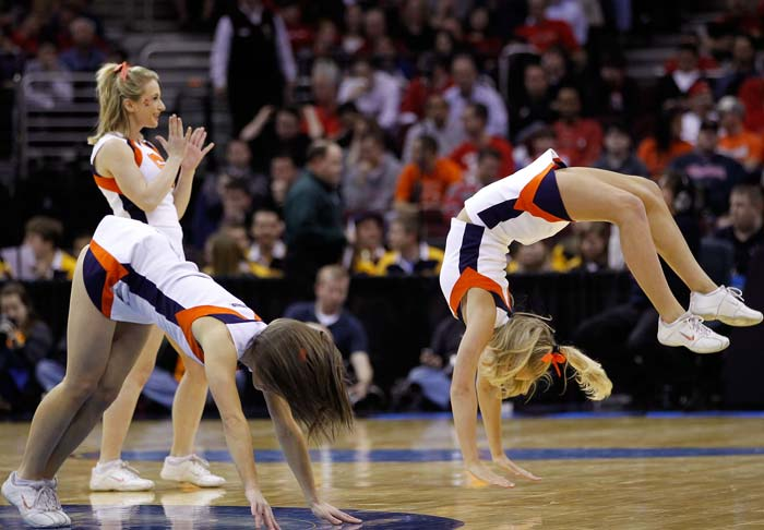 Gymnastics, a strict diet regime and a fitness schedule that can rival that of the strongest body-builder defines the cheerleaders who want to figure and make it big in the American sporting circle. (Getty Images)