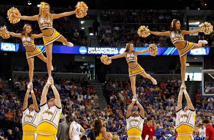 Though American society is also not alien to extensive brand promotions, cheering squads usually only sport the names of their teams. Companies and especially apparel sponsors if any, keep from promoting through cheergirls. Though exact reason is unknown, their presence only during half0time may be a reason. (Getty Images)
