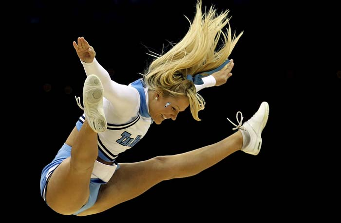 The sheer extent of the limit to which cheergirls put themselves, especially during breaks in NBA and NFL games, sets the appreciation rolling. Colleges have special teams who participate in national competitions. (Yes, you must have seen a few of those movies too...secretly). (Getty Images)