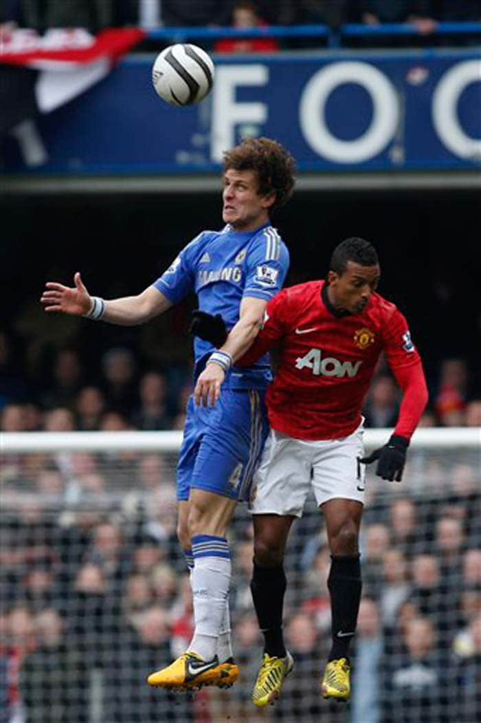 Chelsea's David Luiz competes with Manchester United's Nani during their English FA Cup quarter final replay at Stamford Bridge.
