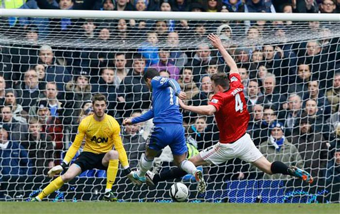 Chelsea's Eden Hazard has a goal attempt blocked by Manchester United's Phil Jones during the English FA Cup quarterfinal replay at Stamford Bridge Stadium in London.