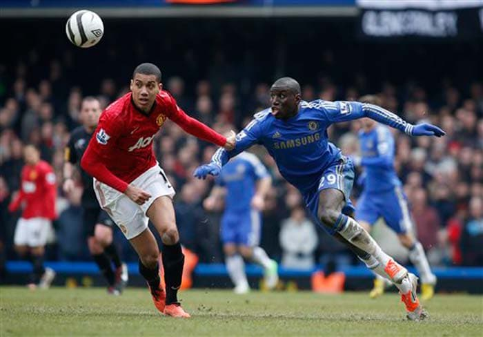 Chelsea's Demba Ba competes with Manchester United's Chris Smalling.