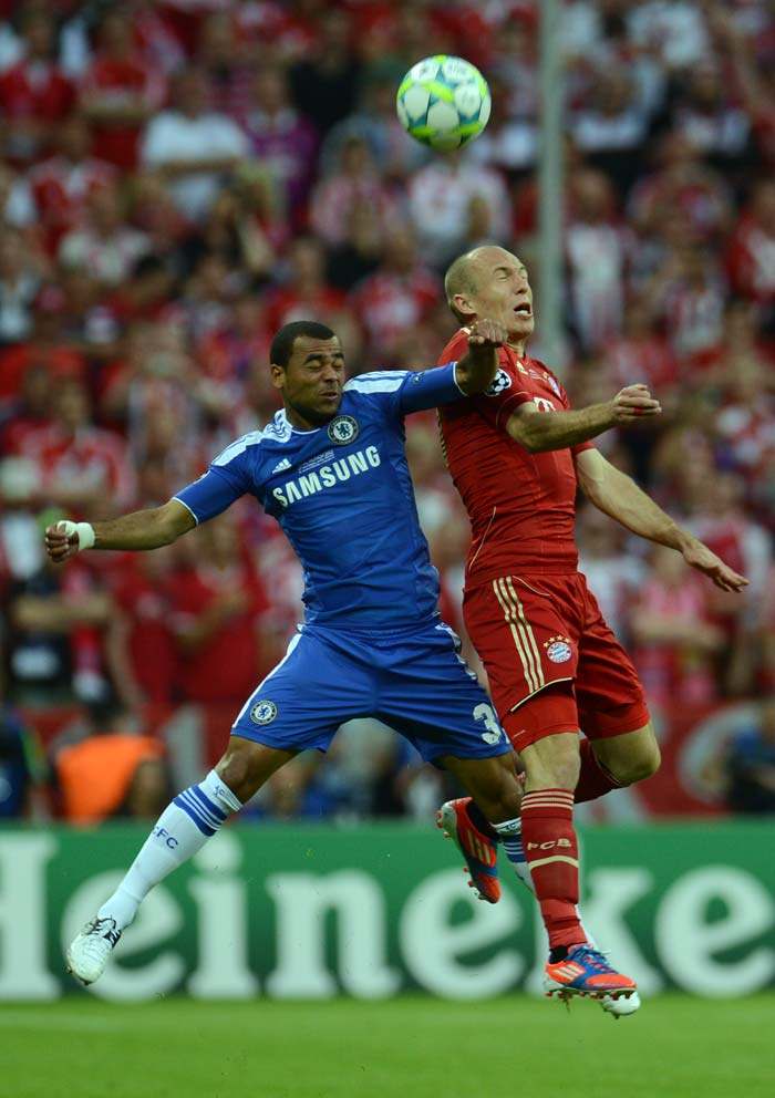 Ashley Cole vies for the ball against Bayern Munich's Arjen Robben (right).