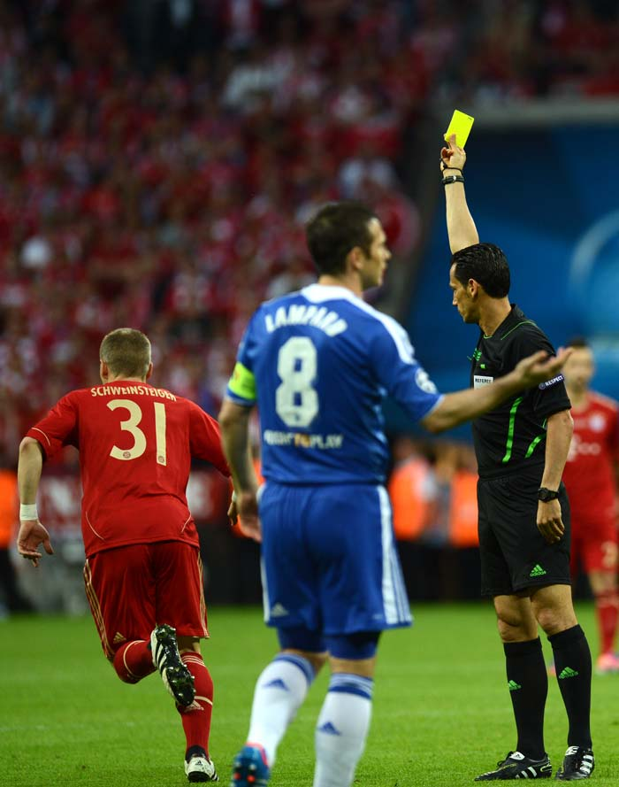 Bastian Schweinsteiger (left) was shown the yellow card in the 2nd minute for deliberate handball.