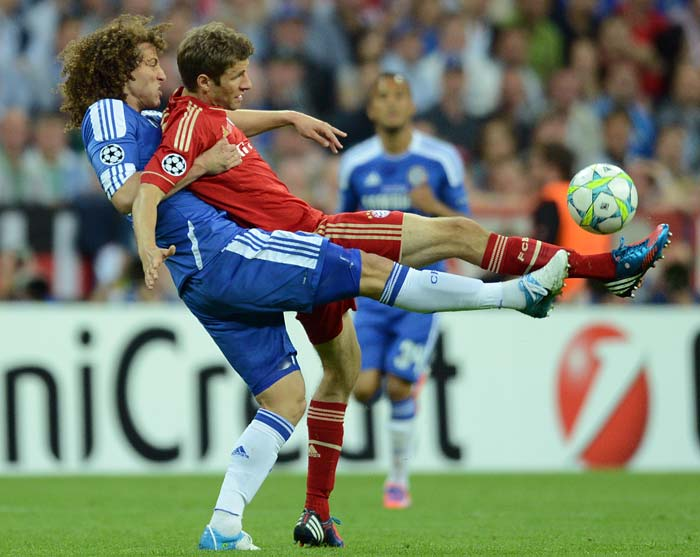 Thomas Muller (right) was marked well for most parts but the Bayern player managed to find the back of the net to put his team ahead.