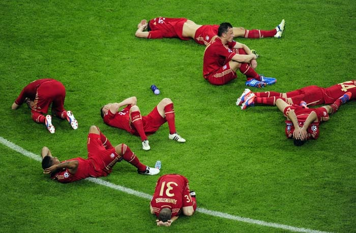 Bayern players in utter dis-belief after crashing to Chelsea in the penalties.