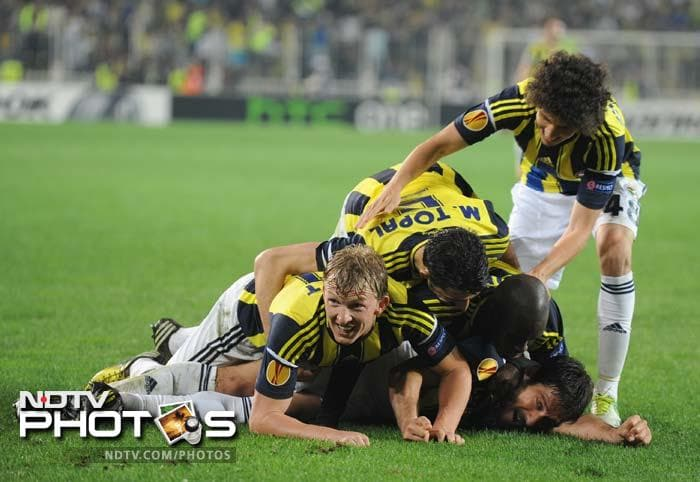 Fenerbahce, seen celebrating their goal here, hold the slightest of edges going into the second leg. They will probably rue the 'missed' chances if Benfica play well at home.