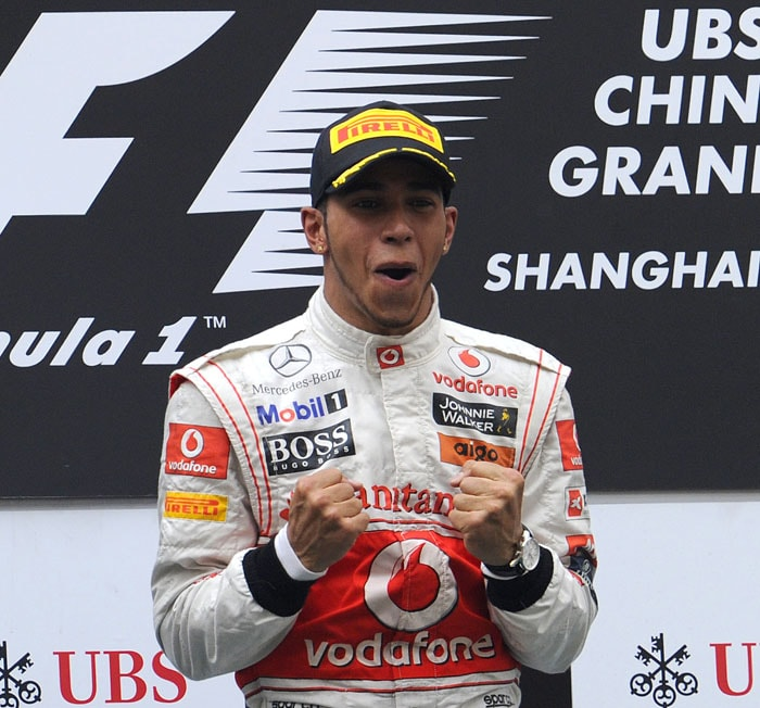 McLaren-Mercedes driver Lewis Hamilton of Britain celebrates on the podium after winning the Formula One Chinese Grand Prix at the Shanghai International Circuit in Shanghai. (AFP PHOTO)