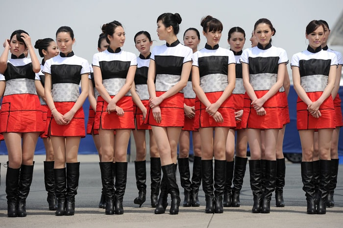 Chinese models stand in line before the Formula One Chinese Grand Prix in Shanghai. (AFP PHOTO)