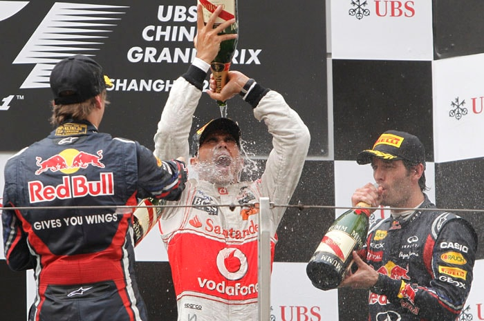 McLaren Formula One driver Lewis Hamilton, centre, of Britain pours champagne over himself as he celebrates after winning the Chinese Formula One Grand Prix at the Shanghai International Circuit in Shanghai, China. Red Bull Formula One driver Sebastian Vettel of Germany was second and his team-mate Mark Webber, right, was third. (AP Photo)
